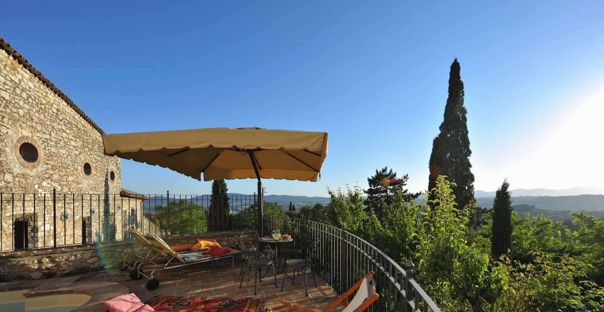 Seating terrace at Santi Terzi villa in Umbria